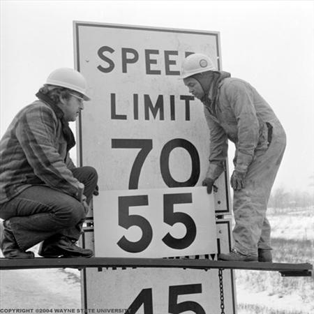 Speed-limit-sign-being-changed